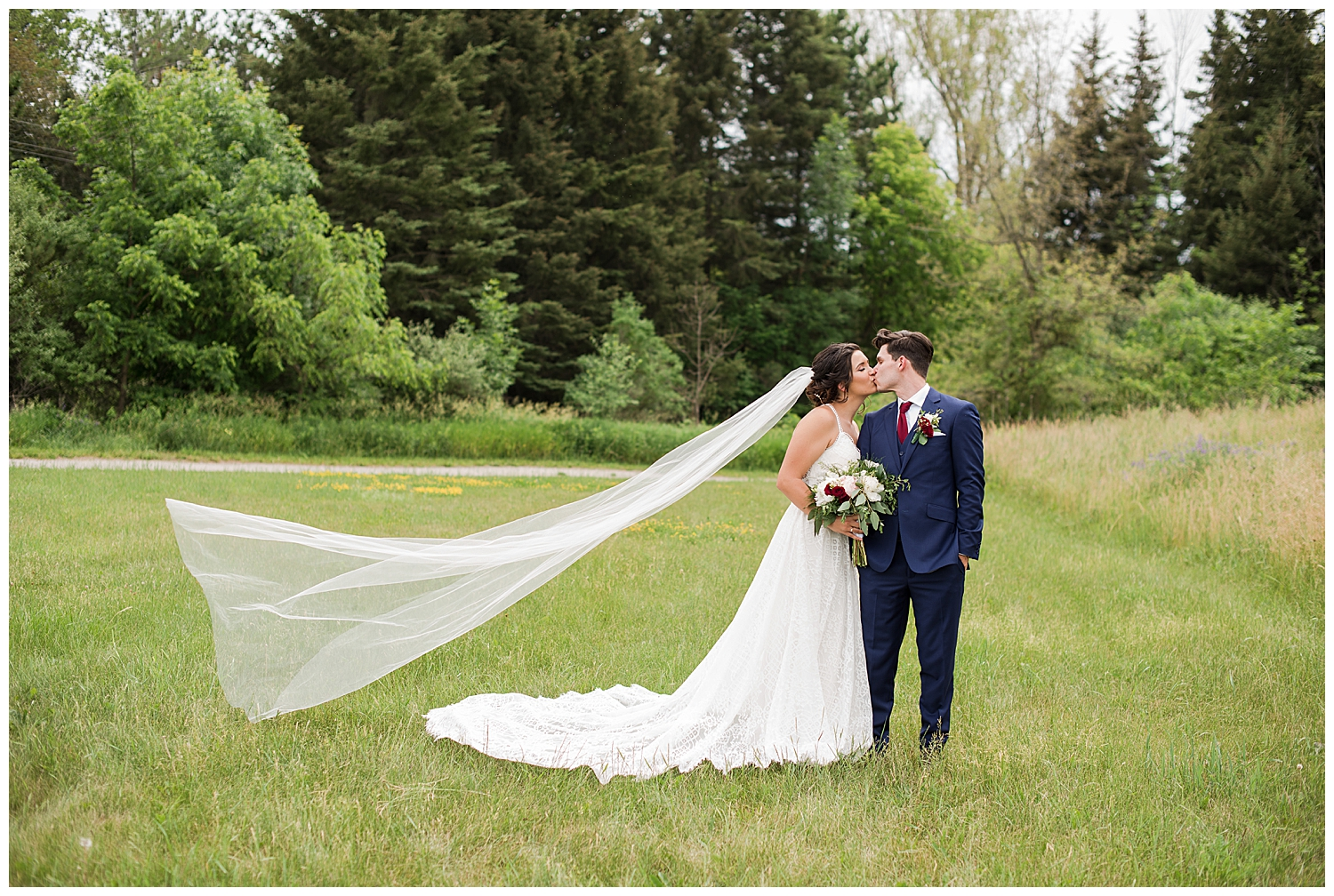 kortright centre bride and groom with veil flying